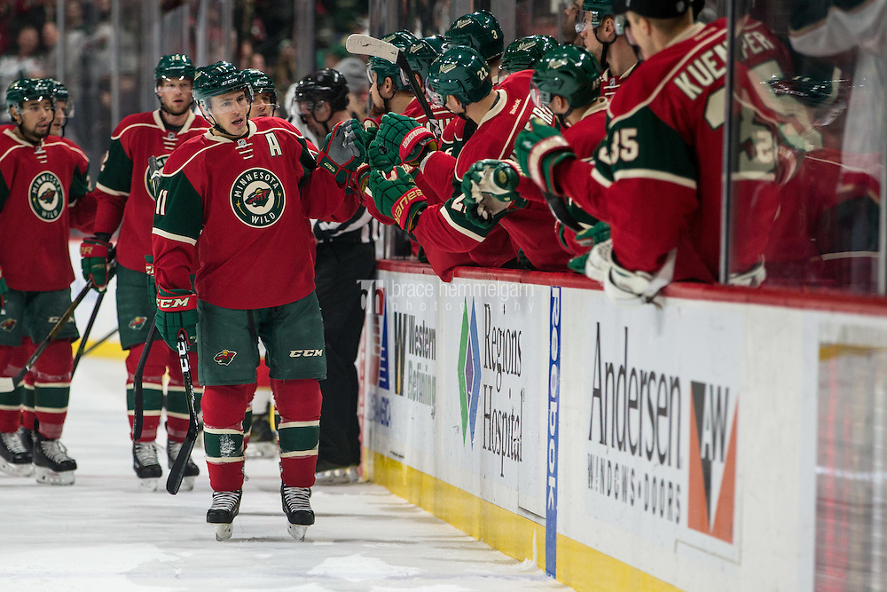 Dec 13, 2016; Saint Paul, MN, USA; Minnesota Wild forward Zach Parise (11) celebrates his goal with teammates during the first period against the Florida Panthers at Xcel Energy Center. Mandatory Credit: Brace Hemmelgarn-USA TODAY Sports