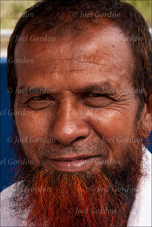 """Head and shoulders portrait of Bangladesh male, he is driver of worker of a boardwalk """"walking cart"""", """"rolling chairs"""" """"push taxi""""  """"push-cart """" waiting for customers along the boardwalk in Atlantic City."""