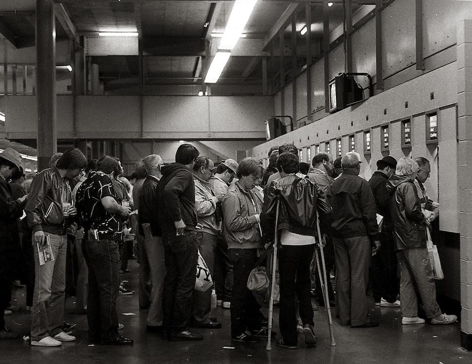 Bettors on line at Belmont Park. 1986.