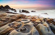 """Bizarre """"Tafoni"""" sandstone formations along the rugged shoreline of Salt Point State Park in Northern Sonoma County, California."""