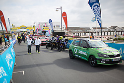 The race convoy slowly assembles before the Aviva Women's Tour 2016 - Stage 1. A 138.5 km road race from Southwold to Norwich, UK on June 15th 2016.