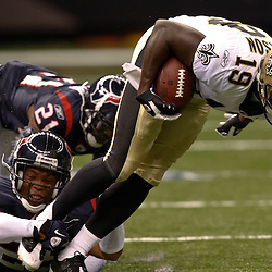August 21, 2010; New Orleans, LA, USA; New Orleans Saints wide receiver Devery Henderson (19) is tripped up by Houston Texans cornerback Glover Quin (29) during the first quarter of a preseason game at the Louisiana Superdome. Mandatory Credit: Derick E. Hingle