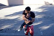 "Don Trip with his son Jaylen, 2, outside of a Memphis, Tennessee barbershop October 15, 2011. Trip's song ""A Letter to My Son"" is about his relationship with Jaylen."