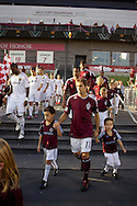 August 4, 2012: Real Salt Lake and the Colorado Rapids players are escorted onto the field by local youth prior to the start of their game at Dick's Sporting Goods Park in Denver, Colorado