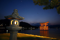 Jan. 24, 2009; Miyajima, Japan - Otori gate and Japanese stone lantern shortly after sunset on Miyajima Island.<br /> <br /> Miyajima is designated as one of Japan's three most beautiful sights to see.