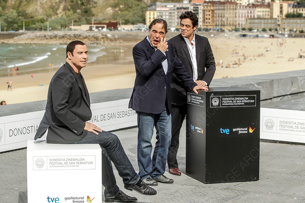 23.SEPTEMBER.2012. SAN SEBASTIAN<br /> <br /> JOHN TRAVOLTA, BENICIO DEL TORO AND OLIVER STONE ATTENDING THE PHOTOCALL FOR 'SAVAGES' AT THE SAN SEBASTIAN FILM FESTIVAL, SAN SEBASTIAN<br /> <br /> BYLINE: EDBIMAGEARCHIVE.CO.UK<br /> <br /> *THIS IMAGE IS STRICTLY FOR UK NEWSPAPERS AND MAGAZINES ONLY*<br /> *FOR WORLD WIDE SALES AND WEB USE PLEASE CONTACT EDBIMAGEARCHIVE - 0208 954 5968*