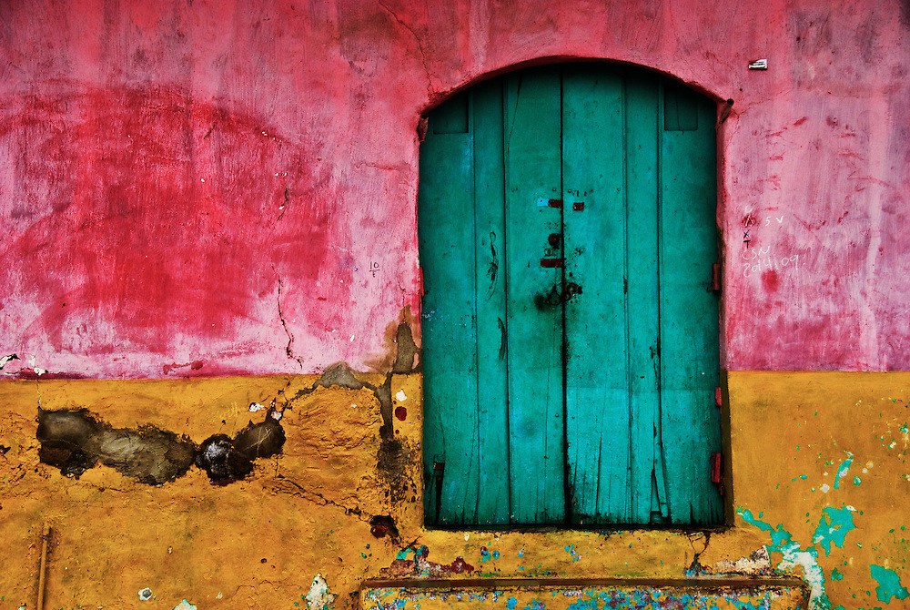 The dilapidated front entrance of a courtyard home in Granada, Nicaragua.