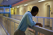 A prisoner standing on one of the landings on E wing. HMP Wandsworth, London, United Kingdom