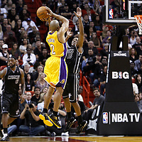 19 January 2012: Los Angeles Lakers point guard Derek Fisher (2) takes a jumpshot over Miami Heat point guard Mario Chalmers (15) during the Miami Heat 98-87 victory over the Los Angeles Lakers at the AmericanAirlines Arena, Miami, Florida, USA.
