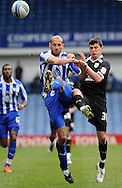 Picture by Graham Crowther/Focus Images Ltd. 07763140036.31/03/12.Rob Jones of Sheffield Wednesday and Graham Cummins of Preston North End challange for the ball during the Npower League 1 match at Hillsborough stadium, Sheffield..
