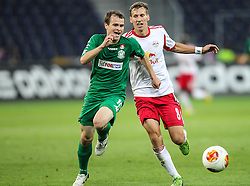 22.08.2013, Red Bull Arena, Salzburg, AUT, UEFA EL Play Off, FC Red Bull Salzburg vs VMFD Zalgiris, Hinspiel, im Bild Pavel Komolov, (VMFD Zalgiris Vilnius, #10) und Florian Klein, (FC Red Bull Salzburg, #8) // during UEFA Europa League Qualification 1st Leg Match between FC Red Bull Salzburg and VMFD Zalgiris at the Red Bull Arena, Salzburg, Austria on 2013/08/22. EXPA Pictures © 2013, PhotoCredit: EXPA/ Roland Hackl