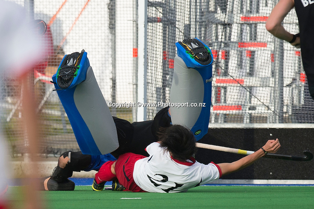 Daisuke Kusano (Front) of Japan collides with Richard Joyce keeper for New Zealand during the Black Sticks Men v Japan international hockey match at the Coastlands Kapiti Sports Turf in Paraparaumu on Saturday the 22nd of November 2014. Photo by Marty Melville/www.Photosport.co.nz