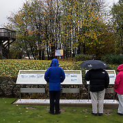 "Visitors near the First Australian Division Memorial in Pozières looking at the information panels that explain the sites, on the back under the trees  is the ""Gibraltar Blockhouse"" and the viewing platform with great views over the WWI battlefields. The Battle of ‪Pozières‬ was a two week struggle (23 July – 7 August 1916) by British and Australian divisions for the capture of the village of Pozieres during  the 1916 battle of the Somme."