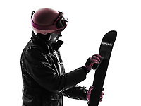 one  woman skier skiing polishing ski in silhouette on white background