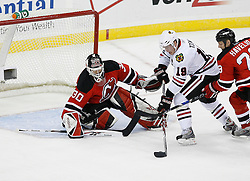 Mar 17, 2009; Newark, NJ, USA; New Jersey Devils goalie Martin Brodeur (30) makes a save on Chicago Blackhawks center Jonathan Toews (19) during the second period of their game against the Chicago Blackhawks at the Prudential Center.