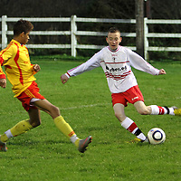 2/11/13 Burren United's Darren Grey in action against Avenue United's Barry Cotter in the Final of the Under 15 Cup held in The County Grounds. Pic Tony Grehan / Press 22