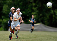 26 MAY 2012 -- TOWN & COUNTRY, Mo. -- Visitation Academy soccer player Hannah Brobst (7) pushes the ball past St. Dominic High School player Emily Monroe (9) during the MSHSAA Class 2 girls' soccer quarterfinals at Visitation Saturday, May 26, 2012. St. Dominic topped the Vivettes 8-1 to advance to Friday's semifinals against Helias Catholic High School at Blue Springs South High School. Photo © copyright 2012 Sid Hastings.