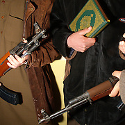 December 23 2003....Rutba, Iraq.....Resistance fighters.....A group of Iraqi resistance fighters show off their assault rifles and grenades during a secret meeting in a safehouse in the town of Rutba near the Jordanian border. They hold a copy of the Koran and declare their willingness to die ridding Iraq of US occupation. This group is responsible for many roadside bomb attacks on US convoys.