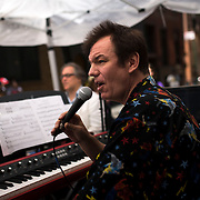 """June 21, 2014 - New York, NY : <br /> The city was flooded with music on Saturday as Make Music New York brought more than 1,300 free concerts to the city's streets and parks. The annual festival's program included the performance """"'In (Key)' - New Compositions in Celebration of Terry Riley's 'In C' @ 50 Years"""" on Cornelia Street, in front of the Cornelia Street Cafe in Greenwich Village, on Saturday afternoon. Pictured here, Patrick Grant, who helped produce the performance, addresses the audience during a break in play. <br /> CREDIT: Karsten Moran for The New York Times"""