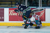 KELOWNA, CANADA - APRIL 30: Sami Moilanen #18 of the Seattle Thunderbirds checks Carsen Twarynski #18 of the Kelowna Rockets to the ice during first period on April 30, 2017 at Prospera Place in Kelowna, British Columbia, Canada.  (Photo by Marissa Baecker/Shoot the Breeze)  *** Local Caption ***