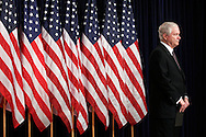 Defense Secretary Robert Gates, stands back and listens as Secretary of State Condolezza Rice addresses a press conference in the Old Executive Office Building January 11, 2007 in Washington, D.C. Photo Ken Cedeno.