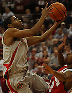 MORNING JOURNAL/DAVID RICHARD.Mike Conley Jr., left, of Ohio State drives to the basket against Kammron Taylor Sunday, Feb. 25, 2007, in Columbus, Ohio. Ohio State beat Wisconsin 49-48.