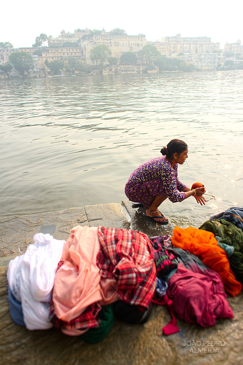 Woman washing clothes at Hanuman ghat