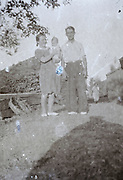 old fading image young family proud posing with their first born child countryside