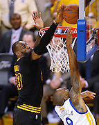 Cleveland Cavaliers forward LeBron James (left) blocks a shot by Golden State Warriors Andre Iguodala during the fourth quarter of game 7 of the NBA Finals on June 19, 2016 in Oakland, California. AFP Photo