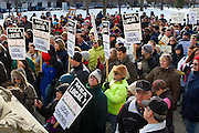 """Protestors rally against Emergency Financial Manager legislation at the Michigan State Capital in Lansing, MI, Tuesday, March 8, 2011. According to the law, which has already been approved in the House, the governor will be able to declare """"financial emergency"""" in towns or school districts and appoint someone to fire local elected officials, break contracts, seize and sell assets, and eliminate services. Under the law whole cities or school districts could be eliminated without any public participation or oversight. (Jeffrey Sauger)"""