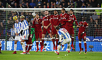 Football - 2017 / 2018 Premier League - Huddersfield Town vs. Liverpool<br /> <br /> Chris Lowe of Huddersfield Town takes a free kick as the Liverpool wall jumps at John Smiths Stadium.<br /> <br /> COLORSPORT/LYNNE CAMERON