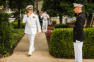 Chaplain Gregory N. Todd salutes a fellow officer following his promotion ceremony on Thursday, June 21, 2018, at Marine Barracks Washington, D.C. LCMS Communications/Erik M. Lunsford