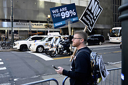 """Protest signs go up as a small group posts across the Loews Hotel in Center City, Philadelphia, Pennsylvania, on January 25th, 2017. On Thursday President Donald Trump and UK Prime Minister Theresa May are expected to join republicans gathered for a """"Congress of Tomorrow"""" Joint Republican Issues Conference."""