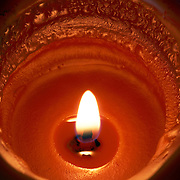 A Pumpkin Spice scented candle burning.