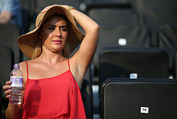 A spectator enjoys the sun during day one of the 2017 AEGON Championships at The Queen's Club, London. PRESS ASSOCIATION Photo. Picture date: Monday June 19, 2017. See PA story TENNIS Queens. Photo credit should read: Steven Paston/PA Wire. RESTRICTIONS: Editorial use only, no commercial use without prior permission, please contact PA Images for further info: Tel: +44 (0) 115 8447447.
