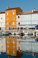Early morning light on the waterfront, in the town of Cres, on the island of the same name, Croatia