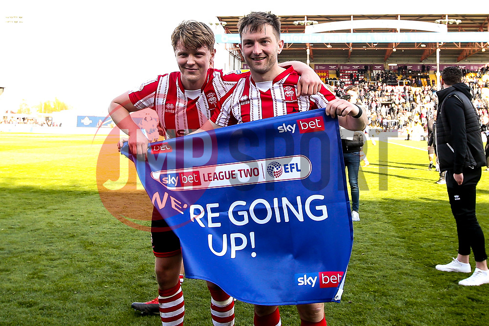 Mark O'Hara and Lee Frecklington of Lincoln City celebrate winning promotion from Sky Bet League Two to Sky Bet League One - Mandatory by-line: Robbie Stephenson/JMP - 13/04/2019 - FOOTBALL - Sincil Bank Stadium - Lincoln, England - Lincoln City v Cheltenham Town - Sky Bet League Two