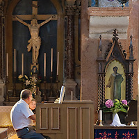VENICE, ITALY - AUGUST 14: An organist and a pupil practise ahead of the Assumption celebration at the Armenian monastery of San Lazzaro on August 14, 2011 in Venice, Italy. The Armenian Monastery is based on San Lazzaro which is a small island in the Venetian Lagoon lying immediately west of the Lido it is completely occupied by the monastery, founded around 1707, is the mother-house of the Mekhitarist Order, the island is one of the world's foremost centers of Armenian culture