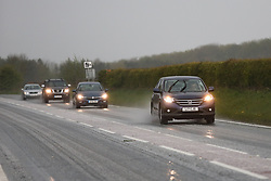 April 25, 2017 - Driffield, East Yorkshire, UK - Driffield, UK. Cars drive through an icy hail shower in Driffield, East Yorkshire  Forecasters are predicting cold temperatures in Britain this week as it is set to be hit by an arctic blast. (Credit Image: © Ian Hinchliffe/London News Pictures via ZUMA Wire)