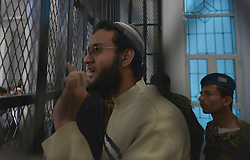 A suspected al-Qaida militant, who is accused of bombing an aircraft at an air force base in May 2012, attends the first hearing of his trial in a state security court in Sanaa, Yemen,  March 4, 2013. Photo by Imago / i-Images...UK ONLY