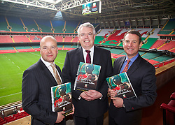 CARDIFF, WALES - Wednesday, April 30, 2014: Jonathan Ford (Chief-Executive of the FAW), Carwyn Jones (First Minister of Wales) and Chris Coleman (Manager of the Wales national team) with the official bid document at the launch of the Football Association of Wales bid for hosting a UEFA Euro 2020 fixture at the 74,154 capacity Millennium Stadium. (Pic by David Rawcliffe/Propaganda)