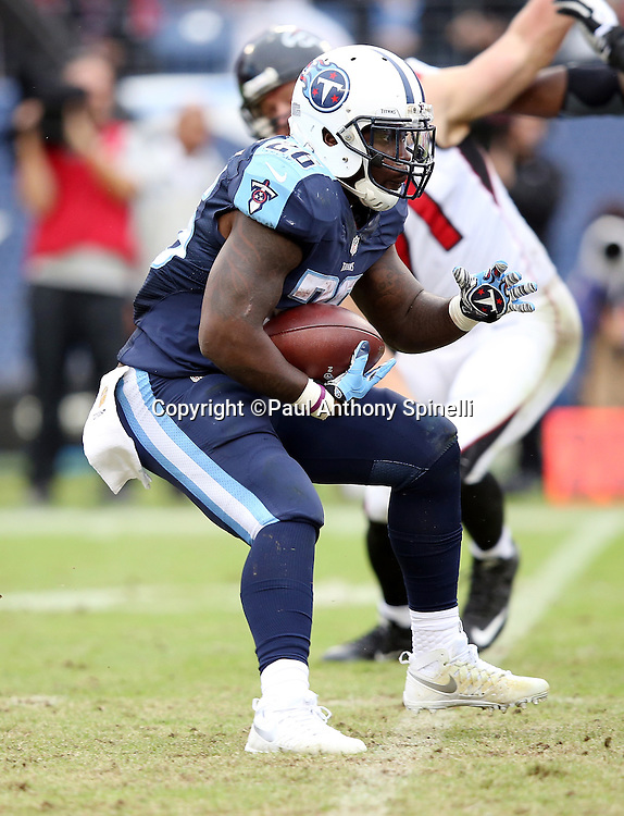 Tennessee Titans running back Antonio Andrews (26) makes a cut as he runs the ball during the 2015 week 7 regular season NFL football game against the Atlanta Falcons on Sunday, Oct. 25, 2015 in Nashville, Tenn. The Falcons won the game 10-7. (©Paul Anthony Spinelli)