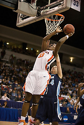 Virginia center Aisha Mohammed (33) shoots a layup past Old Dominion forward/center Megan Pym (44).  The #11 ranked / #5 seed Old Dominion Lady Monarchs defeated the #24 ranked / #4 seed Virginia Cavaliers 88-85 in overtime in the second round of the 2008 NCAA Women's Basketball Championship at the Ted Constant Convocation Center in Norfolk, VA on March 25, 2008.