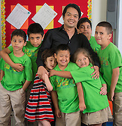 Osias Mendoza poses for a photograph with his students at Love Elementary School, May 20, 2015.