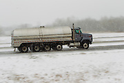 A tanker truck drives on interstate 43 in Green Bay, Wisconsin druing a snow strom in March 2011.(Photo by Mike Roemer)