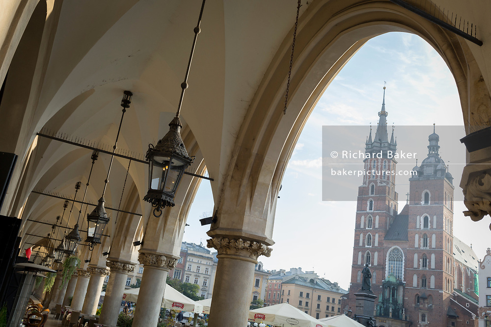 Renaissance arches of the Cloth Hall and the towers of the Church of St Mary on Rynek Glowny market square, on 23rd September 2019, in Krakow, Malopolska, Poland.