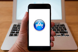 Using iPhone smartphone to display logo of Apple App Store