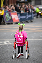 © Licensed to London News Pictures . 19/05/2019. Manchester, UK. Pride of Britain winner ELLA CHADWICK participating in the event . Participants on Portland Street in Manchester City Centre at the start of the Great Manchester Run . Photo credit : Joel Goodman/LNP