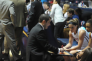 "Mississippi Lady Rebels head coach Matt Insell talks with Mississippi Lady Rebels guard Gracie Frizzell (12) and the rest of the team before the game against Georgia at the C.M. ""Tad"" Smith Coliseum in Oxford, Miss. on Thursday, January 15, 2015.  (AP Photo/Oxford Eagle, Bruce Newman)"