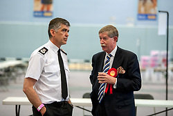 © Licensed to London News Pictures.06/05/2016. Bath, UK.  Avon & Somerset Chief Constable Andy Marsh talks to Kerry Barker the Labour candidate in the A&S PCC election count. Sue Mountstevens (Independent) the current office holder, beats Kerry Barker (Labour) to win the Avon & Somerset Police and Crime Commissioner election, after second round counting at the declaration at Sport Training Village, University of Bath. Photo credit : Simon Chapman/LNP